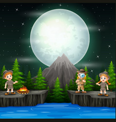 three explorer children with campfire in night vector image