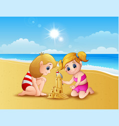 Two girl making sand castle at the beach vector