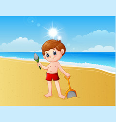 boy playing a sand with shovel vector image
