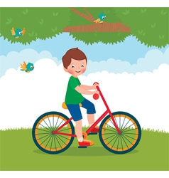 Boy rides a bike vector image