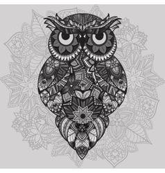 Patterned owl on ornamental mandala vector