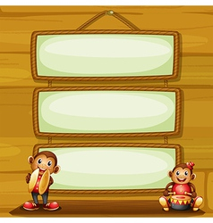 Two musical monkeys in front of the hanging vector image