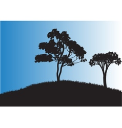 Silhouettes of two tree in fields vector