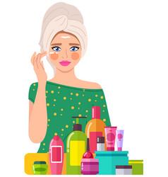Beautiful girl applying moisturizer cream on her vector