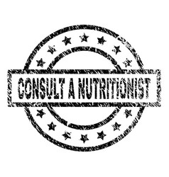 Grunge textured consult a nutritionist stamp seal vector