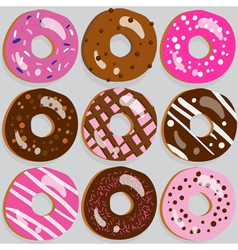 Set of 9 assorted doughnut icons with toppings vector
