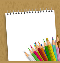 empty notebook with color pencils vector image