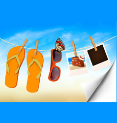 flip flops sunglasses and photo cards hanging on vector image