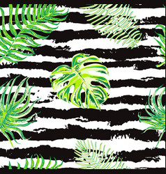 Seamless pattern with tropical leaves on black and vector