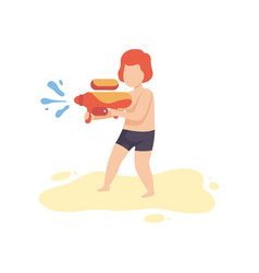 Cute boy playing with water gun on beach on summer vector