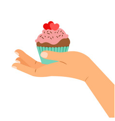 hand holding cupcake with two hearts vector image