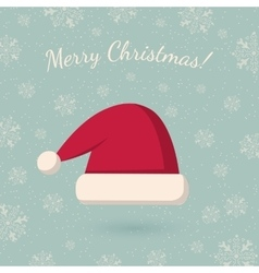 Christmas hat on winter backdrop vector image