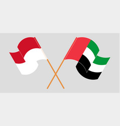 Crossed and waving flags indonesia vector
