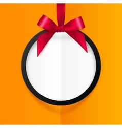 Black round hanging frame with red silky bow and vector image vector image