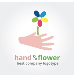 Two hands holding colored flowers nature logotype vector