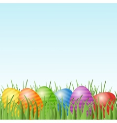 Easter card with eggs on green grass vector image