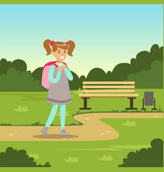 beautiful smiling girl with backpack walking in vector image