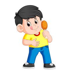 cute boy eating a deep fried chicken vector image