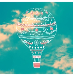 with decorative hot air ballon in blue sky vector image