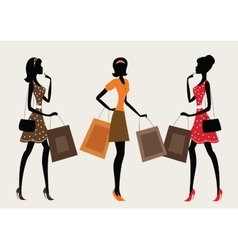 Three silhouettes of a women shopping vector