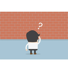 Businessman standing in front of a large brick wal vector image