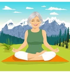 senior woman meditating in mountains vector image vector image