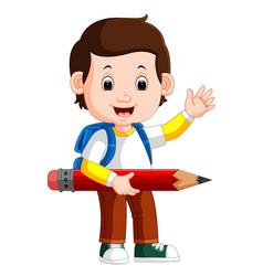boy holding big pencil vector image vector image