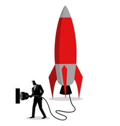 businessman plugging in a rocket vector image