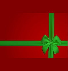 realistic green bow and ribbon isolated on red vector image