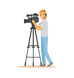 Television video operator with camera on tripod vector