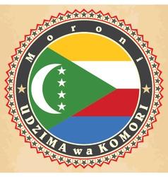 Vintage label cards of comoros flag vector