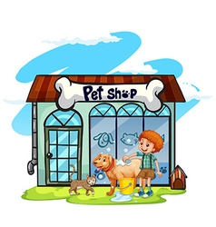 Boy washing dog at pet shop vector image