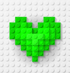 Green heart made of construction kit vector