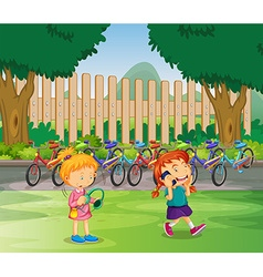 Two girls hanging out in the park vector