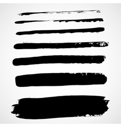 A set of grunge ink strokes vector