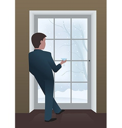 Businessman looking out window vector
