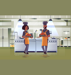 Professional chefs couple holding trays with vector