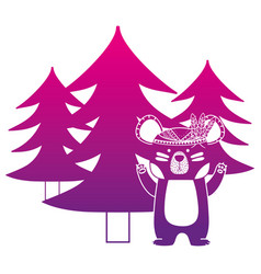 Color silhouette ethnic bear animal with pine vector
