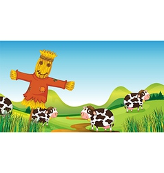 A scarecrow and cows vector image vector image
