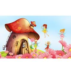 A big mushroom house with fairies vector