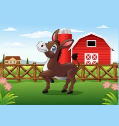 Cartoon happy donkey with farm background vector