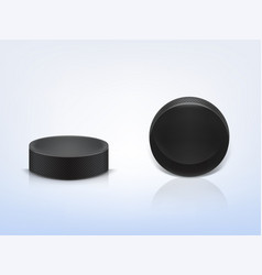 realistic black rubber puck to play hockey vector image