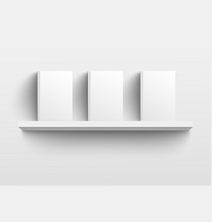 white book shelf mockup with three books vector image