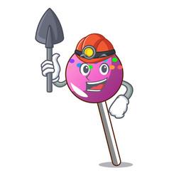 Miner lollipop with sprinkles mascot cartoon vector