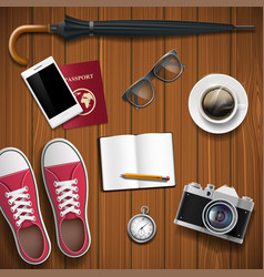 objects for travel on a wooden background vector image