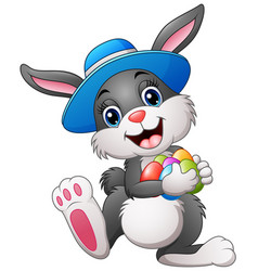 Happy easter bunny wearing a hat carrying eggs vector