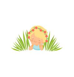 Lovely little girl lying on meadow wearing wreath vector