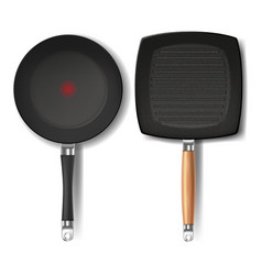 Set with two realistic black frying pans vector