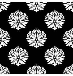 Arabesque pattern of floral motifs on black vector image vector image