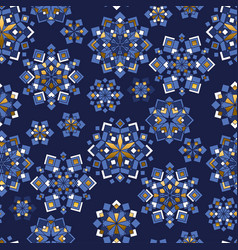 blue and gold snowflakes geometric pattern vector image